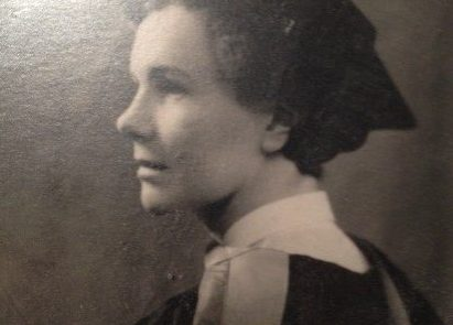 A black and white headshot of Elaina's grandmother wearing graduation robes
